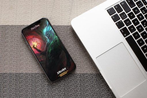 mockup of an iphone xs lying next to a laptop 25393 1